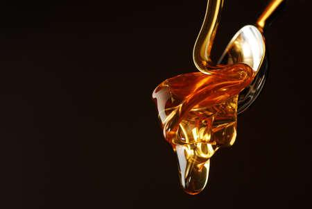 Golden honey dropping  photo