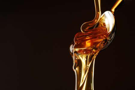 drippings: La miel que fluye de la cuchara  Foto de archivo
