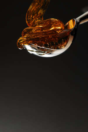 Honey being poured into a spoon