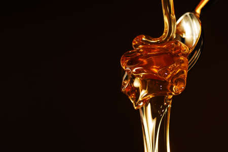 Golden honey isolated on black with copy space stock photo photo