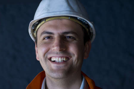 Underground construction worker exited and feeling extremely happy Imagens