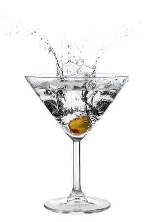 Olive splashing on cocktail isolated on white
