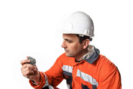 skepticism: Mine engineer checking mineral isolated on white stock photo Stock Photo