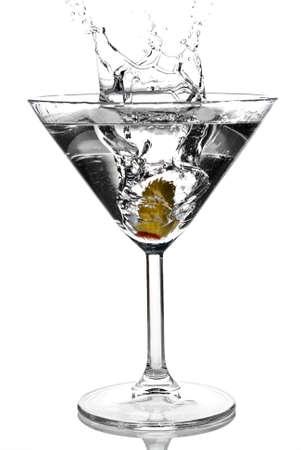 Olive splashing on martini isolated on white stock photo photo