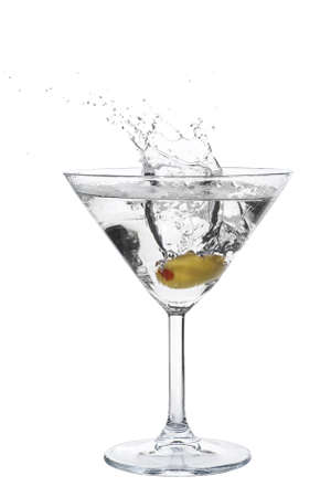 martini glass: Cocktail splash with an olive on isolated background