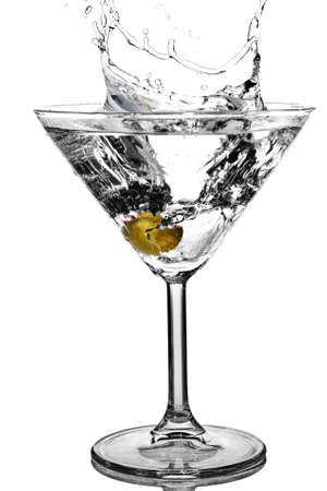 Cocktail olive splash on martini glass with white background Stock Photo