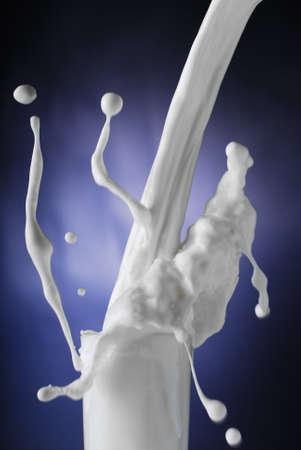Fresh milk splashing as it is poured in a glass