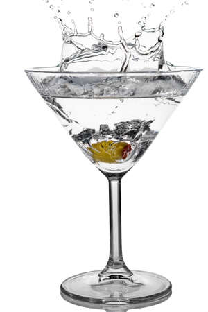martini glass: Cocktail olive splash on martini glass with white background Stock Photo