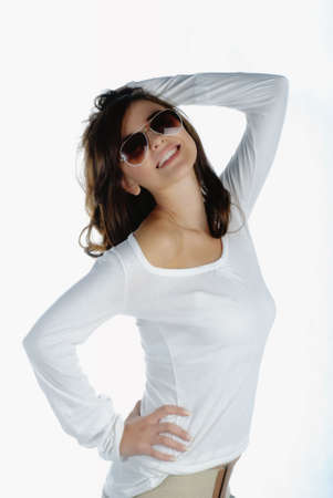 Beautiful young woman with sunglasses isolated on white