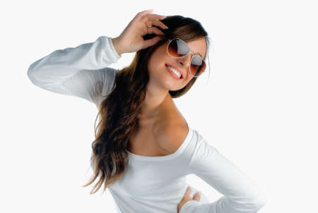 Beautiful happy girl with sunglasses isolated on white photo