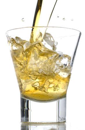 Splash of whiskey on the rocks stock photo