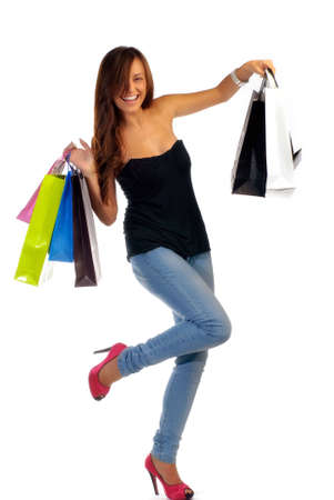 Beautiful young woman holding shopping bags isolated on white photo