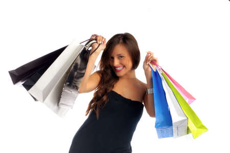 mania: Beautiful young woman holding shopping bags isolated on white