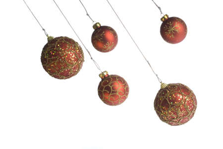 Red Christmas balls hanging over white background