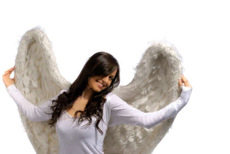 angel alone: Young woman proudly holding her angel wings isolated on white Stock Photo