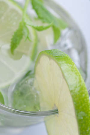 Closeup of lime in a glass of mojito with ice photo