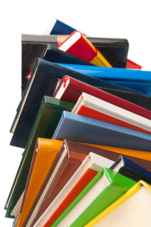 stacked books: Colorful Books stacked one over the other isolated on white