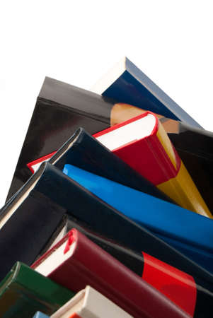 New books stacked one over the other isolated on white Stock Photo - 10543384