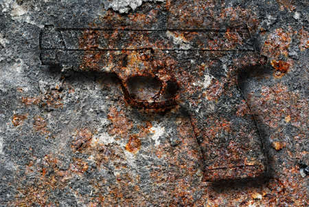 iron oxide: Rusty metal plate with a gun