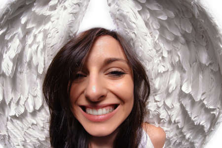 Young woman with angel wings isolated on white taken with fish eye lens Imagens