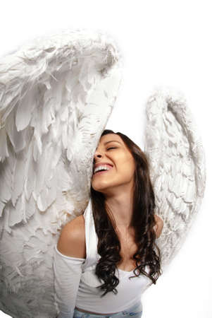 gracious: Young woman standing with angel wings isolated on white taken with wide angle lens Stock Photo