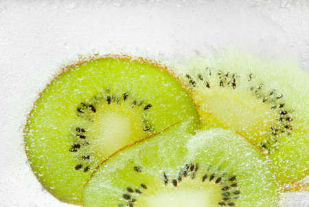 Green slices of kiwi in a refreshing sparkling water Stock Photo