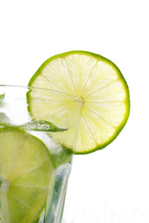 Green mojito with a slice of lime isolated on white