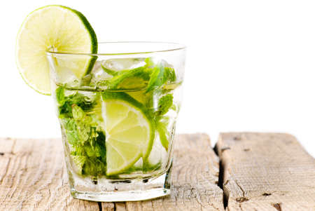 Glass of mojito on a wooden table isolated on white Stock Photo