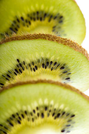 side lighting: Slices of kiwi closeup side lighting focus control Stock Photo
