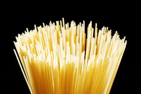 Italian spaghetti rods circular arrangement isolated on black