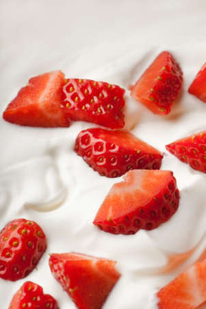 Vertical shot of strawberries in white whipped cream
