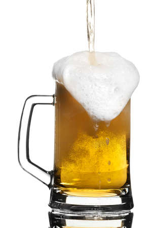 overflow: Light beer overflowing in a glass mug Stock Photo