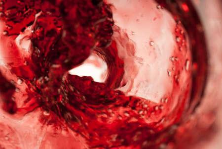 Blood red wine vortex shot from inside the bottle
