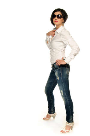Young adult in shirt and jeans isolated on white photo