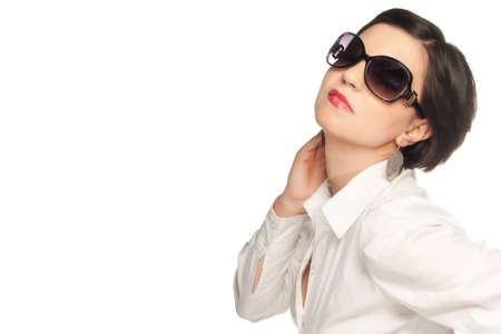 A girl in a white shirt with sunglasses isolated on white photo