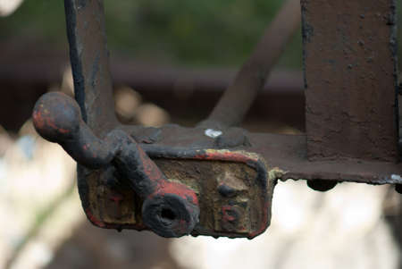Coroded steel metal switch in rust isolated bokeh Stock Photo - 13243253