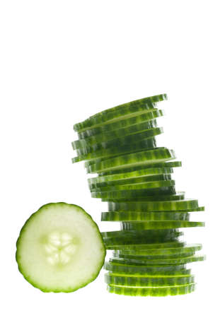 A tower of green vegetable slices on white photo