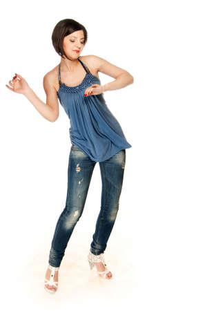 Girl posing in blue outfit on a white backdrop photo