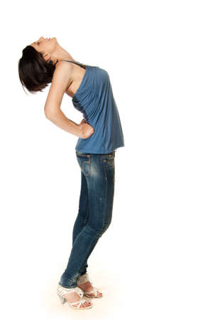 Young adult in blue jeans isolated on white photo