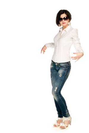 White shirt, blue jeans and sunglasses girl on white photo