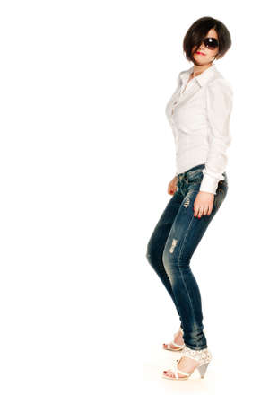 Side shot of an attractive girl in jeans isolated on white photo
