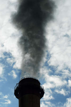 emission: Dark smoke coming out from a coal plant Stock Photo