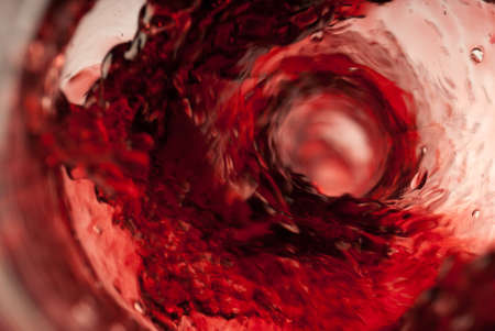 insider: Pouring red wine insider shot in the bottle