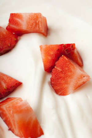 contrasty: Contrasty strawberry pieces on a white cream