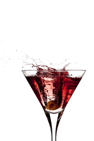 tunneling: Tunneling green olive through a red martini isolated on white Stock Photo