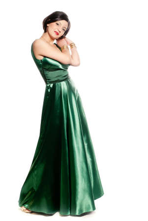 the whole body: Lonh green dress on a young lady isolated on white
