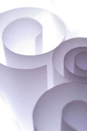 overexposed: Paper curls in A4 size overexposed in studio Stock Photo