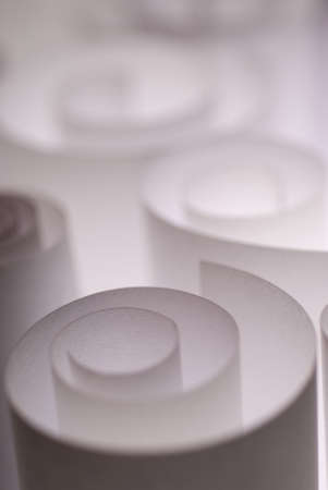 Selective focus on white curled paper pieces photo