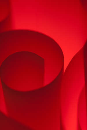 Hard edged spiral made of red paper macro photo