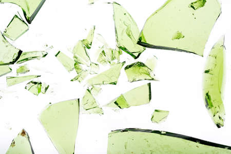 shards: Green shattered bottle pieces isolated on white Stock Photo